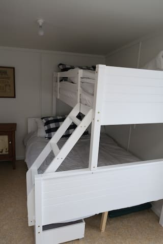 Bunk room with child's bed