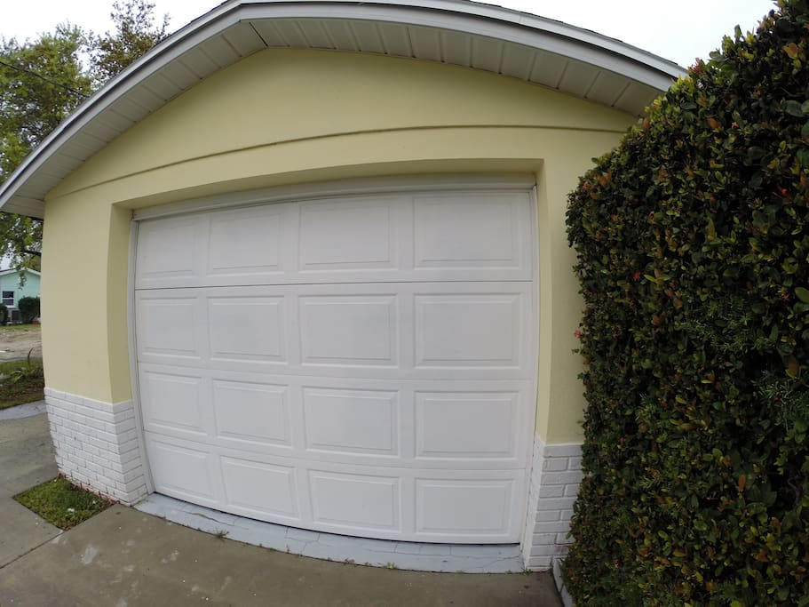 One car garage with very large washer and dryer.