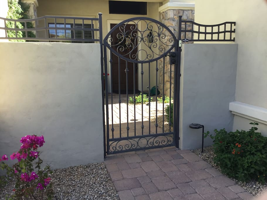Iron gate entrance to your guest house