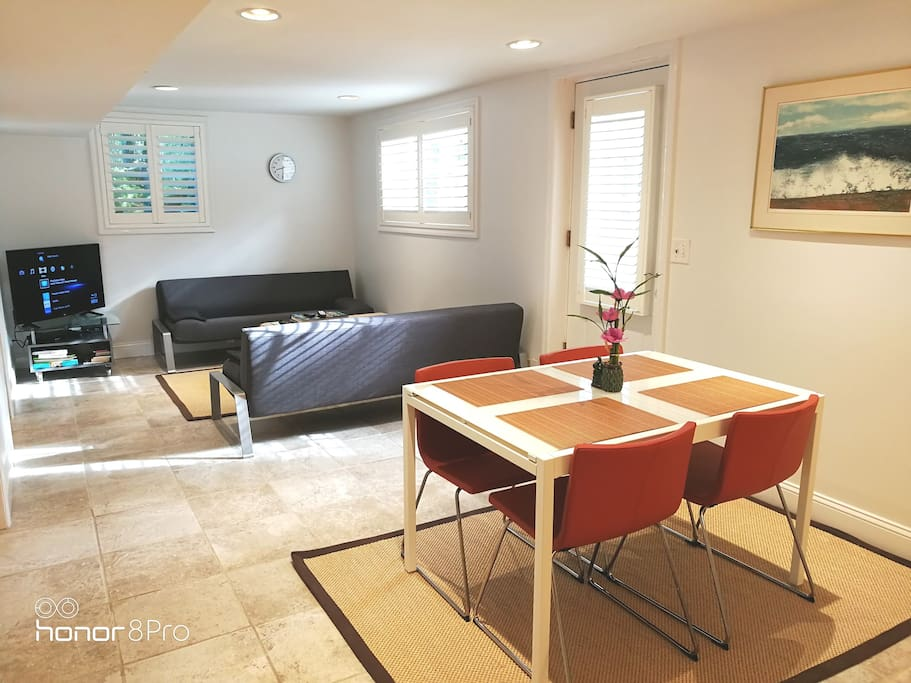 Large Living/Dining/TV with bright natural light.