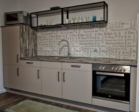 1 Raum-Apartment - Küche Bad Terrasse