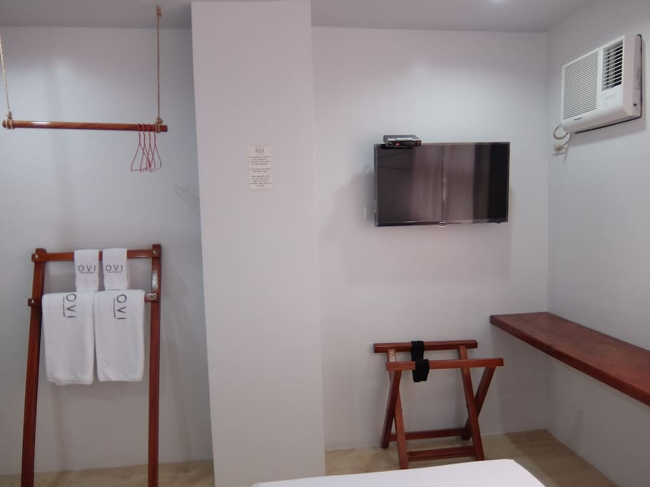 """DIY closet, towel holder, luggage holder, 42"""" cable television & air-conditioned unit"""