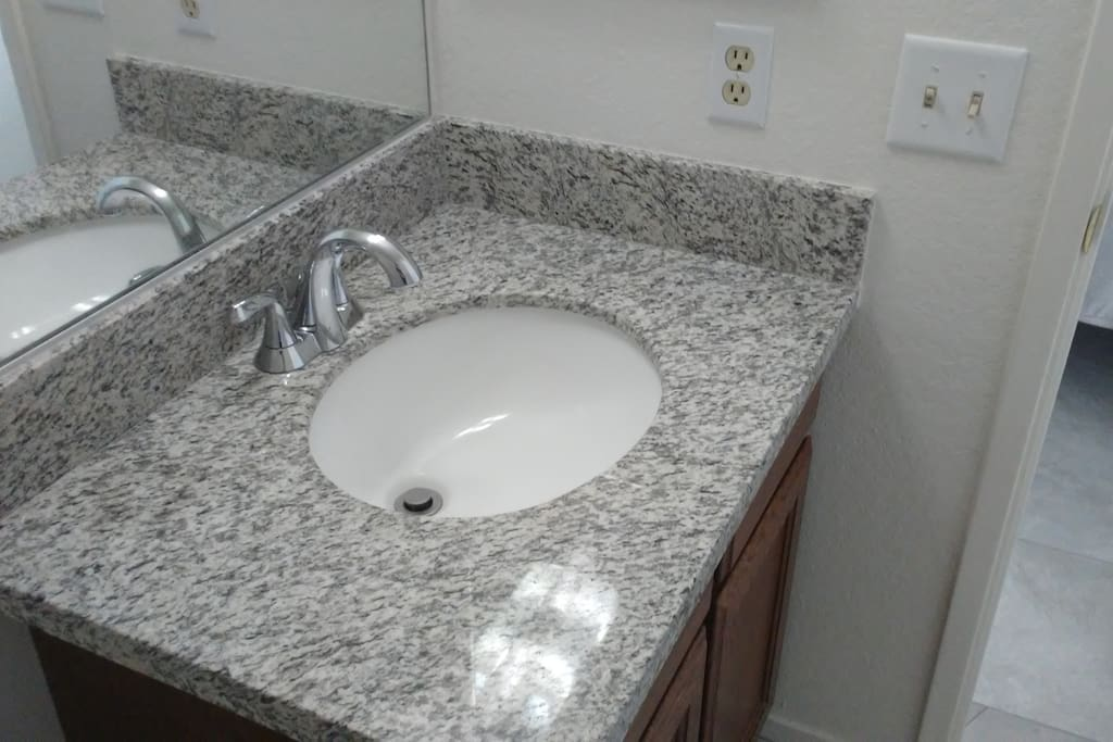 Both bathrooms, and the kitchen all have brand new real Granite countertops.
