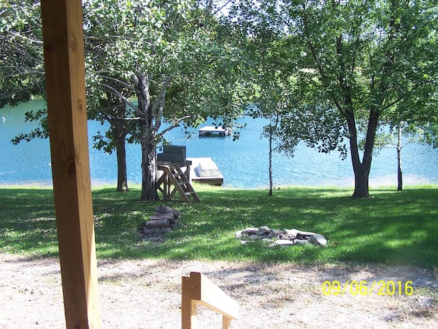 View from the front porch of cabin, the platform is for a zip line into the lake.
