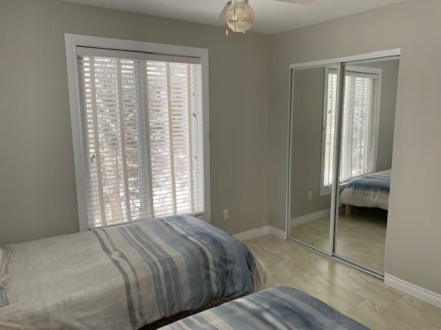 Upstairs bedroom with 1 single and 1 double bed