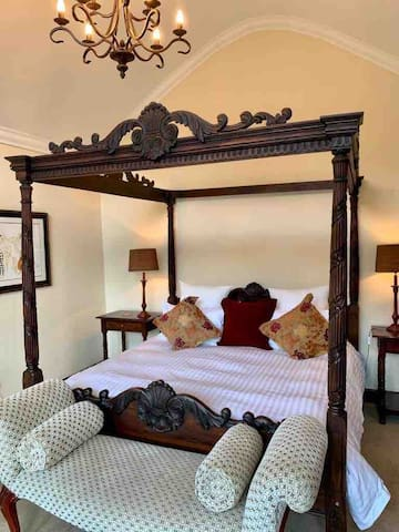 The comfortable 4 poster bed in the Master bedroom