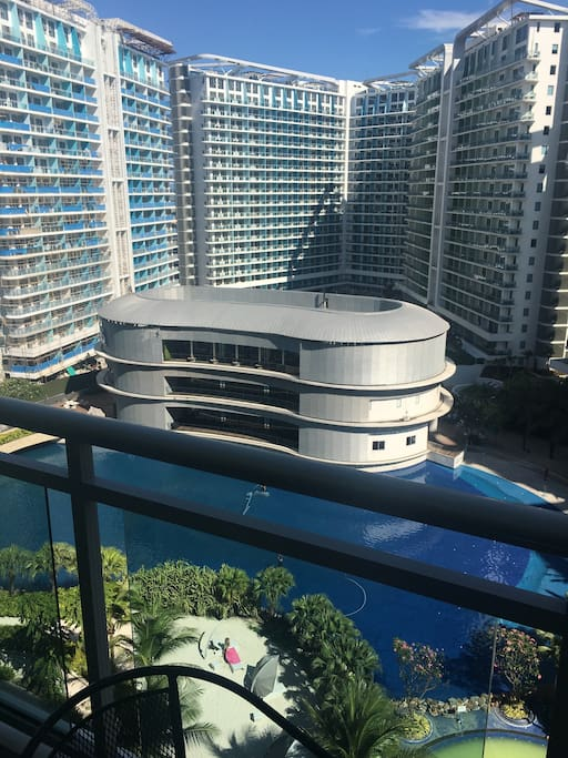 View from the balcony. The large building beside the pool has a gym and restaurant inside.
