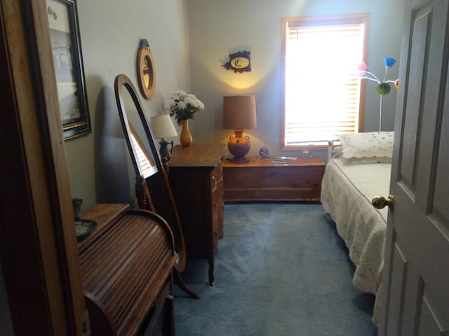 The second bedroom has a twin bed and dresser for your use as well as a full length mirror and place for hanging clothes.