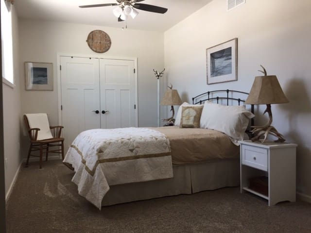 Spacious bedroom w/ queen sized bed.  Two master walk-in closets.  Darkened blinds if you prefer to sleep in.  Ceiling fan w/ lights.