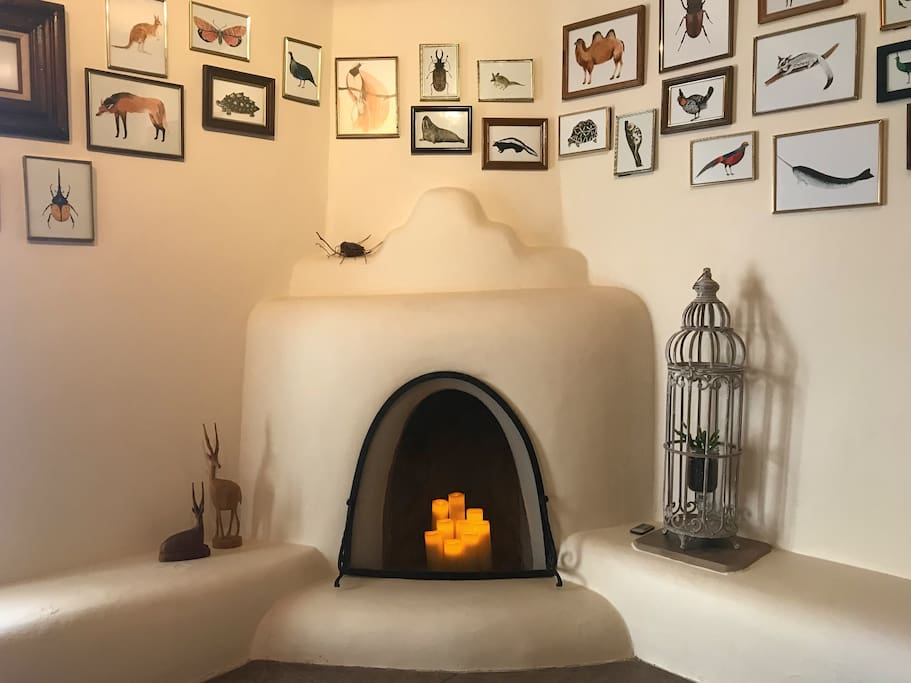 The clubhouse at casa artesia casas de campo en alquiler en taos traditional kiva fireplace with electric candles for added ambiance solutioingenieria Gallery