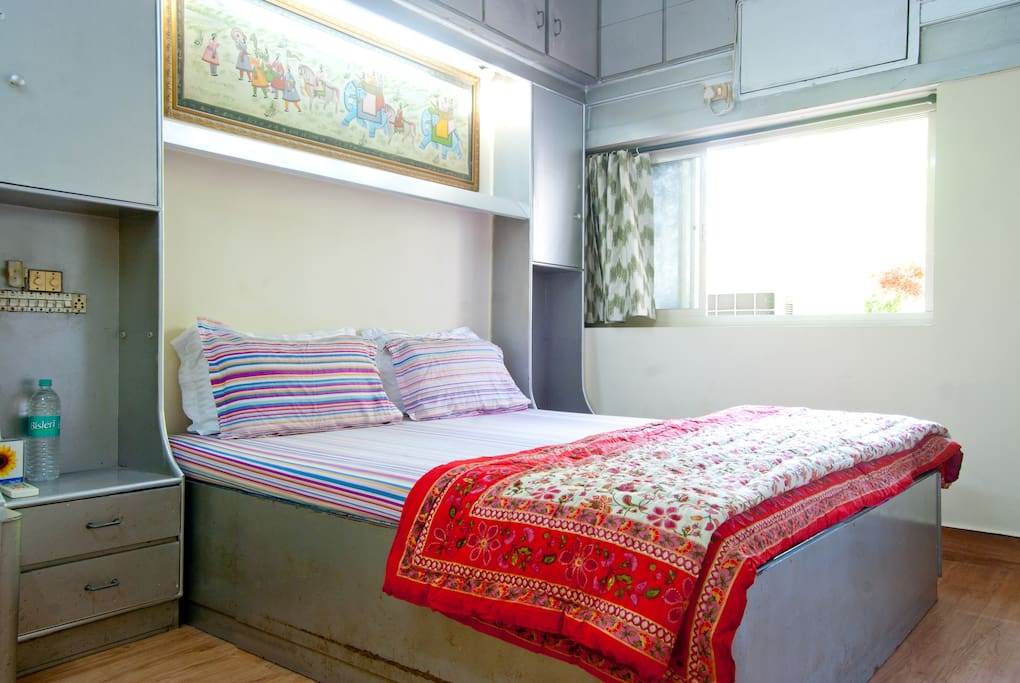 Guest Bedroom with AC and plenty of natural light