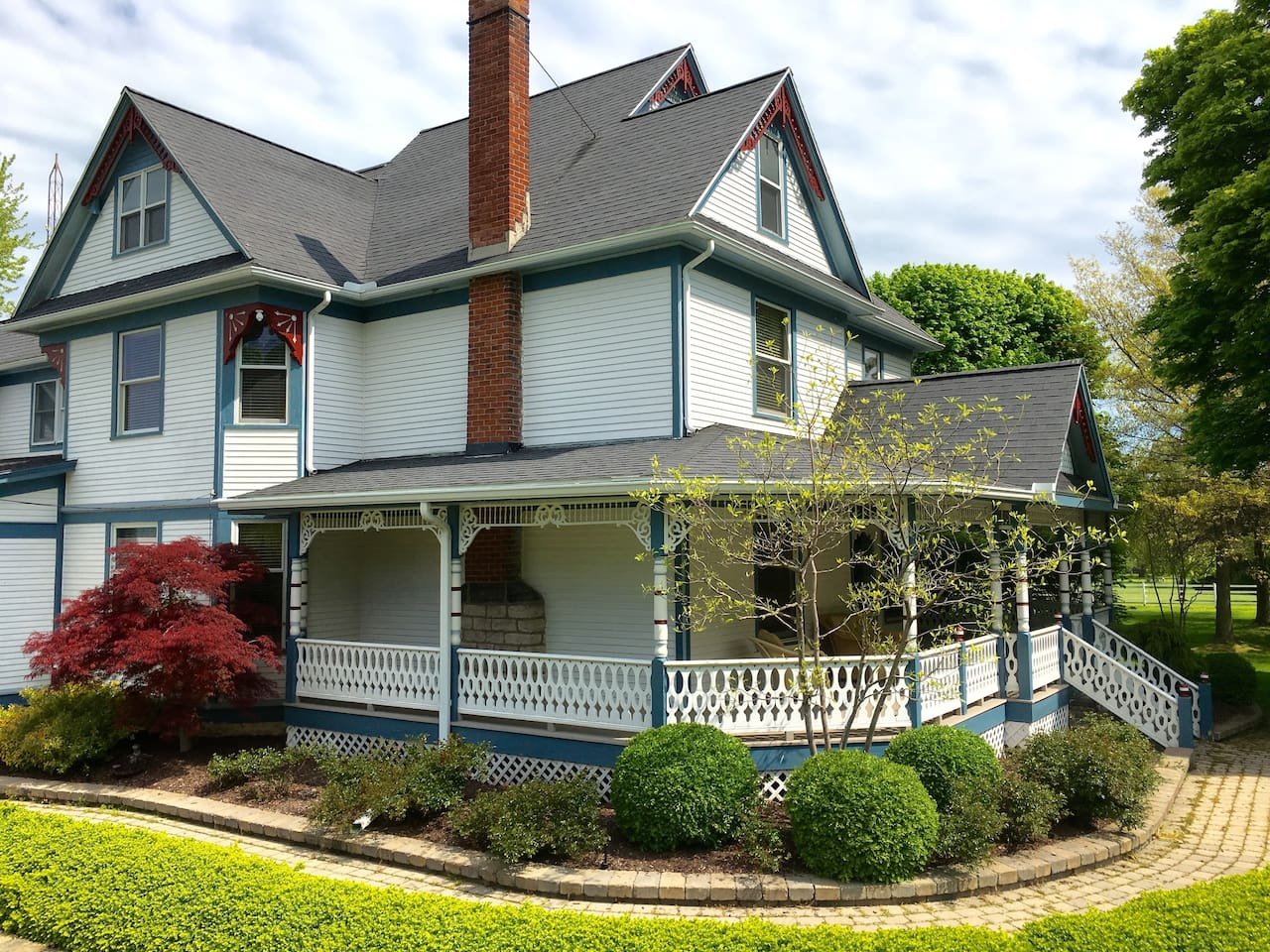 The front view of the Dellwood Estate with its wraparound porch.
