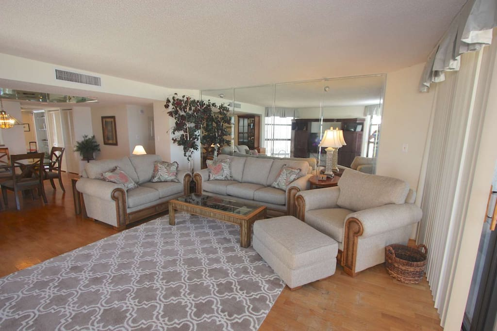 Enjoy a Movie with the Family on the Flat Screen TV and Relax in this Spacious Living room with Breathtaking Views