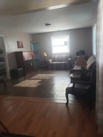 Open floor plan living room, with lots of natural sunlight