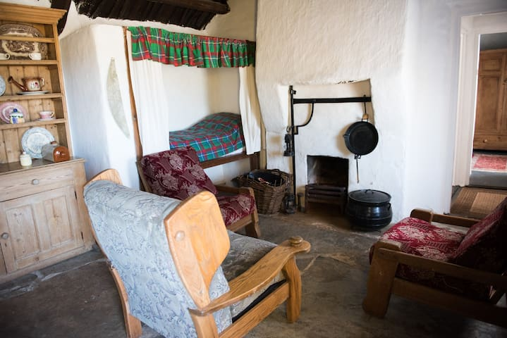 Open fire and traditional kitchen bed