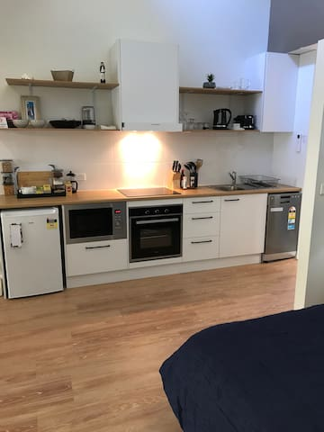 full Kitchen with microwave and dishwasher