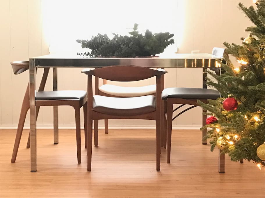 A glass dining table that can easily expand to fit six.