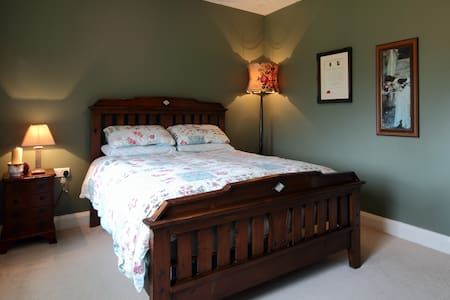 King-sized bed with large bathroom