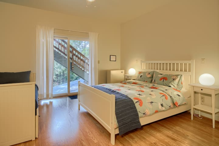 Bedroom with queen and twin bed and patio access!