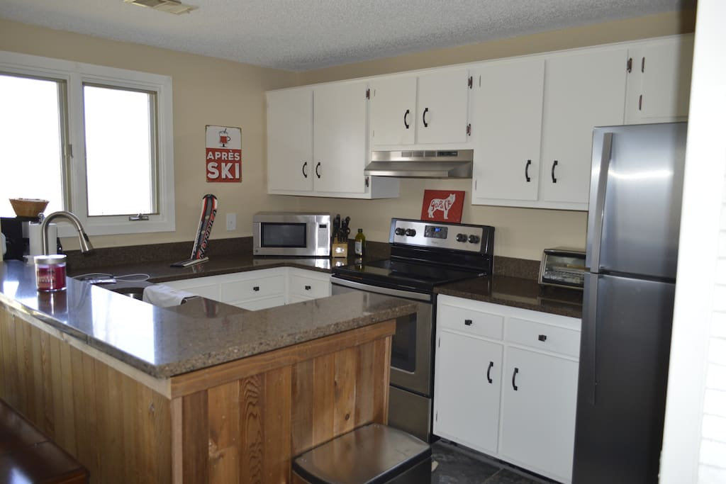 Beautiful kitchen with stainless appliances, including dishwasher.  Stocked with all the dishes, utensils, and glassware you'll ever need, along with a full sized washer and dryer.