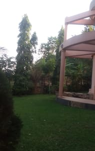 Serene house with leafy garden - Bunamwaya