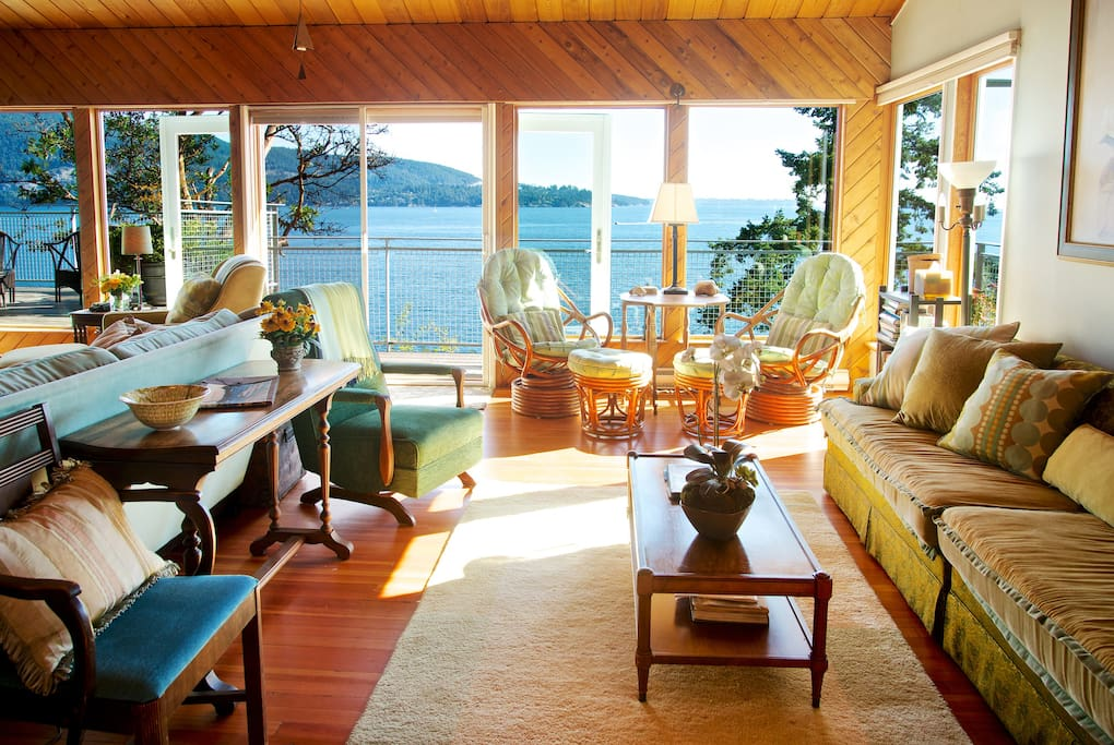 Sun drenched living room winter through summer all with spectacular southerly sea views.