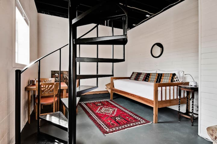 Twin bed in the basement space