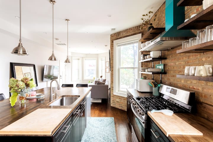 Soft Leather & Warm Bricks in Stylish New Home