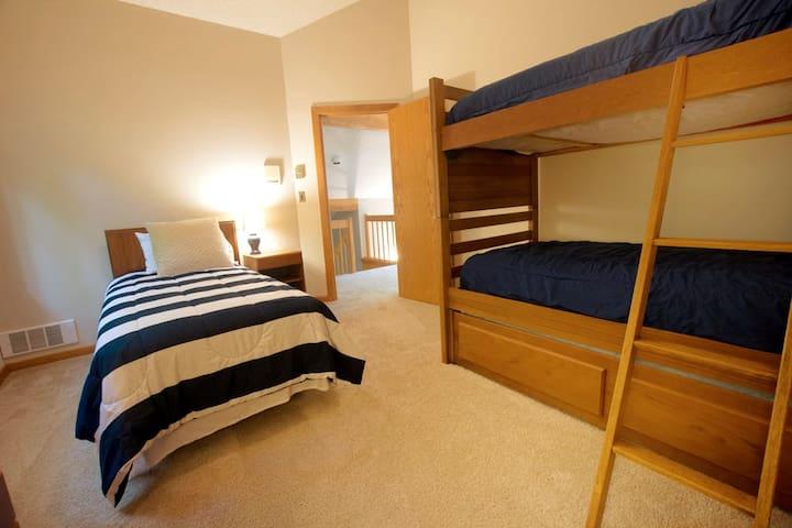 Upstairs bedroom bunk beds plus single (2 of 5 bedrooms)