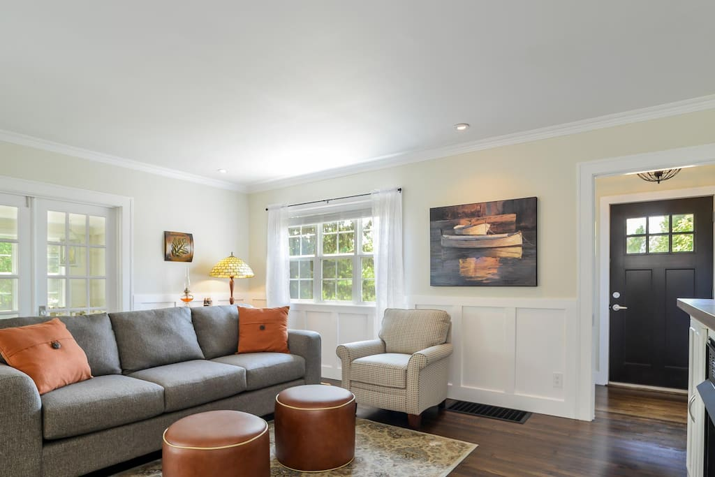 The bright living area features a gas fireplace and TV.