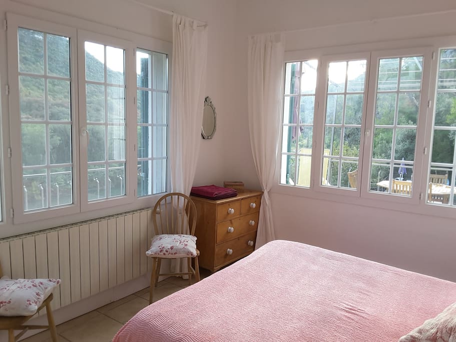 The mater bedroom is a lovely light room and has a double bed with river views from two sides