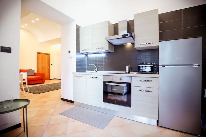 The fully-equipped kitchen with refrigerator and oven
