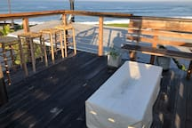 View from rooftop deck, wraparound bench, with firepit (covered)