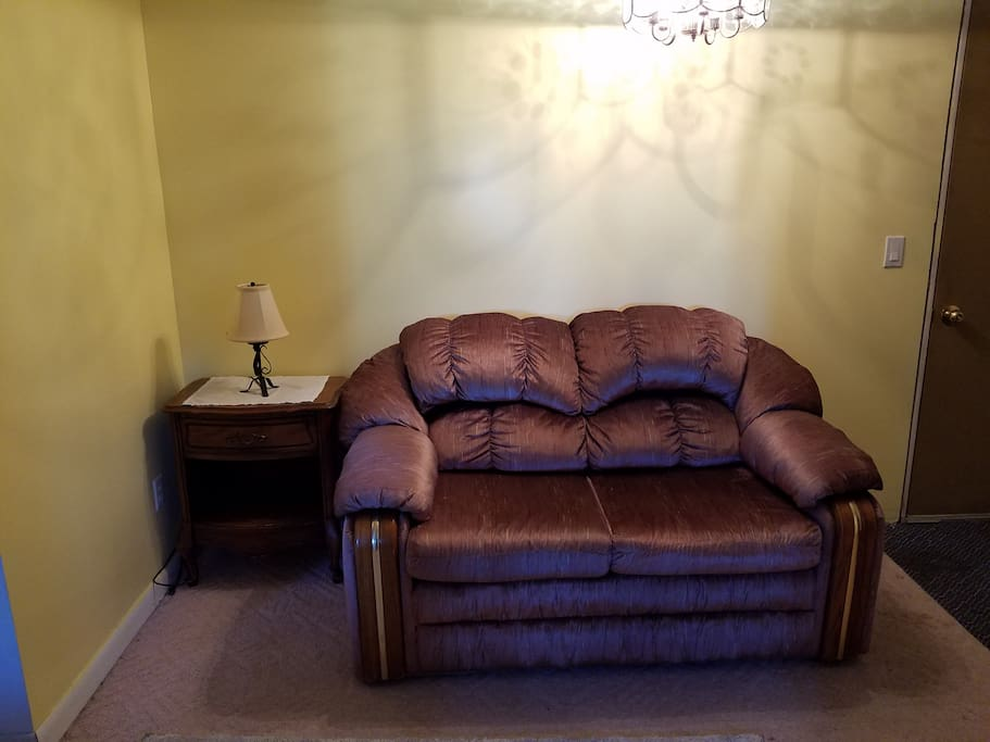 Small living room with loveseat and end table.