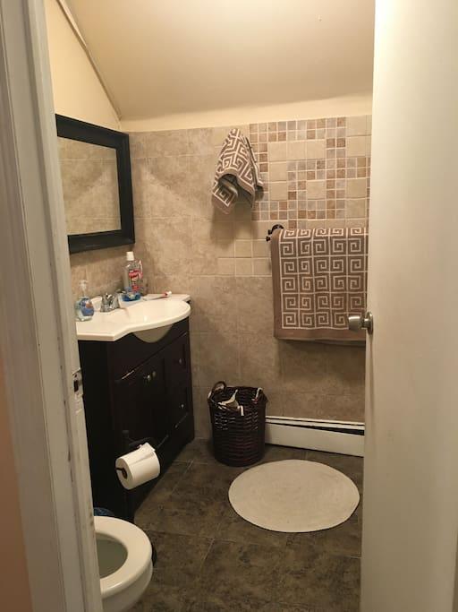 Full bathroom right outside bedroom