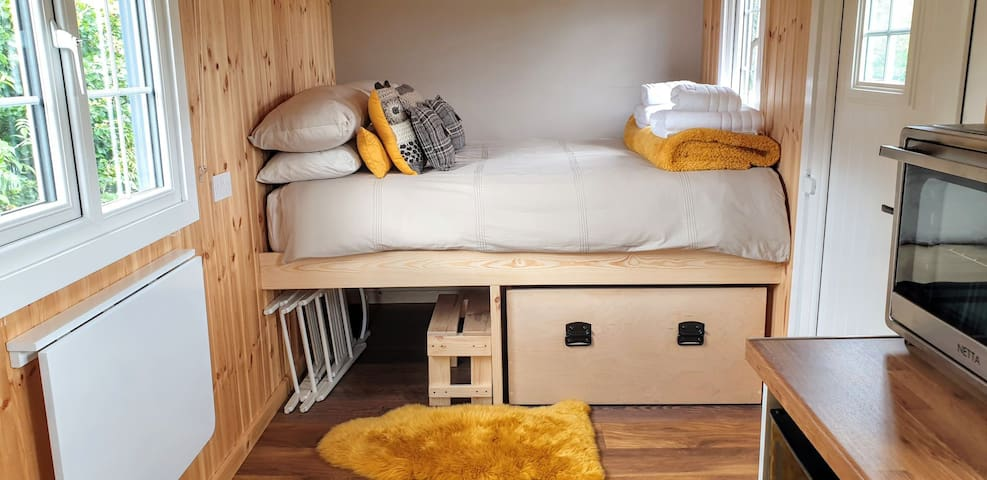 High standard double bed with plenty of storage underneath. Step to help get on the bed.