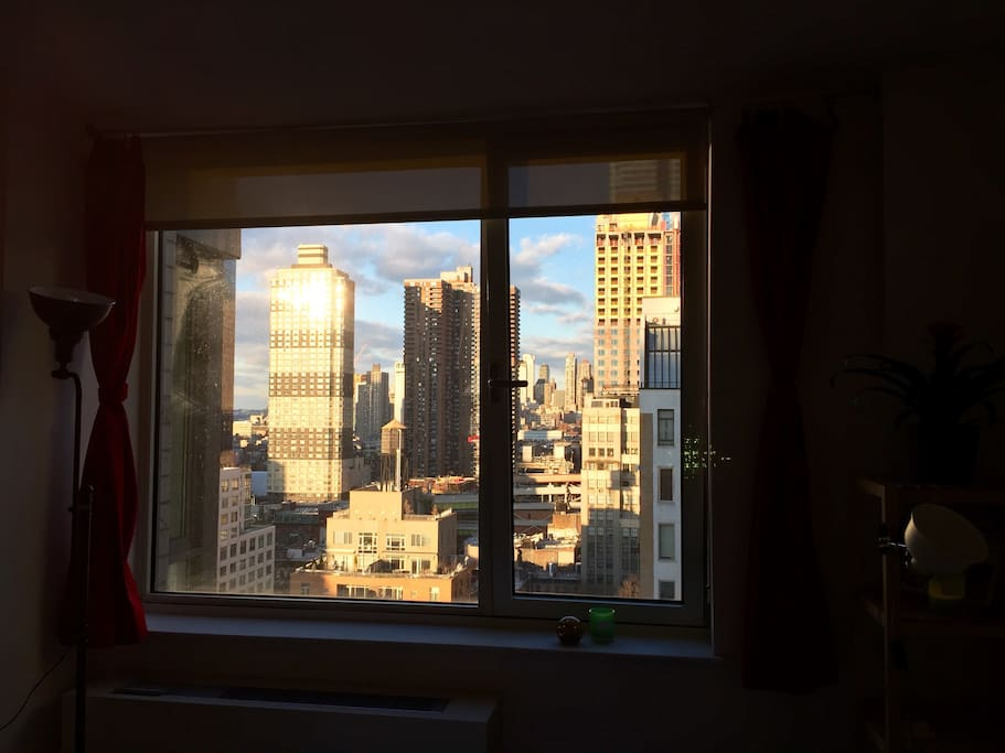 View of the late afternoon sun from your bedroom window. Apartment faces north, towards Hell's Kitchen.