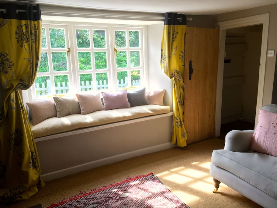 Sunbathed window seat in the sitting room.