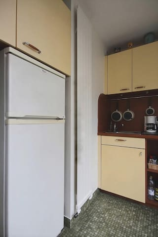 Kitchen: The 3 sqm separated kitchen has a bay window facing courtyard. It is equipped with : fridge, freezer,dishwasher,ceramic hob,extractor hood, oven,microwave, coffee maker,kettle, and utensils,built-in shelves and wall closet,tiled floor.