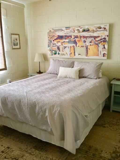 Queen bed in private bedroom.