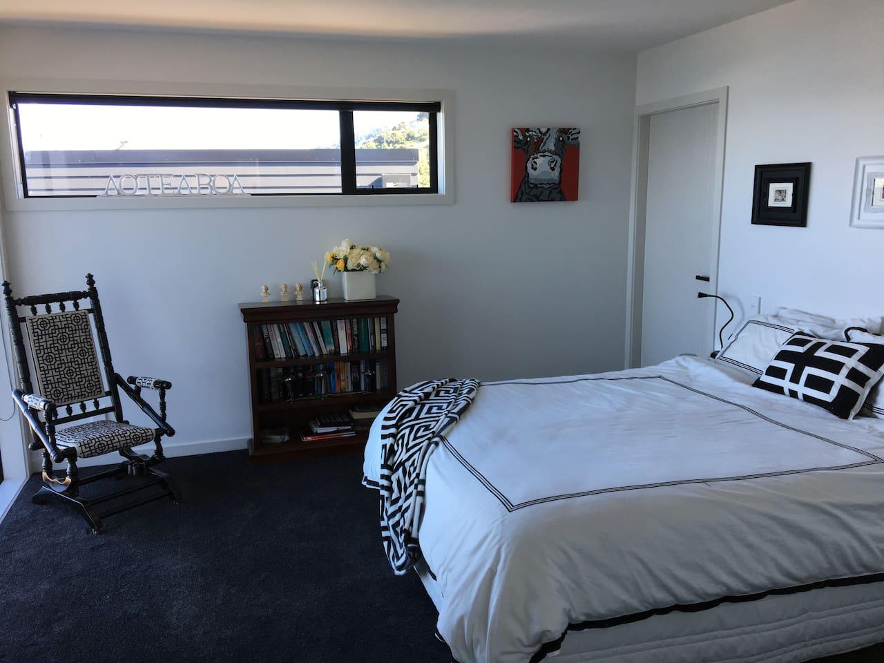 Bedroom 1 with Queen Size bed, walk in robe and en suite