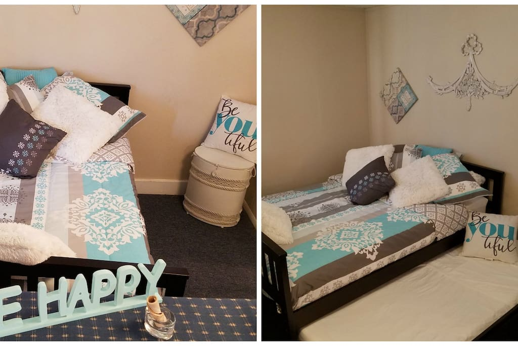 Bedroom area with a New FULL size bed & mattress with an incredibly comfortable, memory foam mattress topper. And a TWIN size mattress is hidden underneath, in a pull-out trundle.