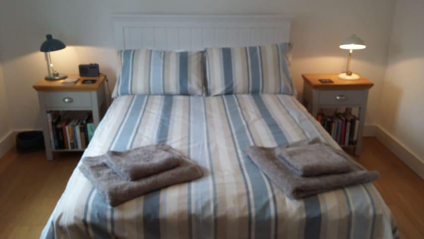 Bedroom one promises comfortable and peaceful sleep