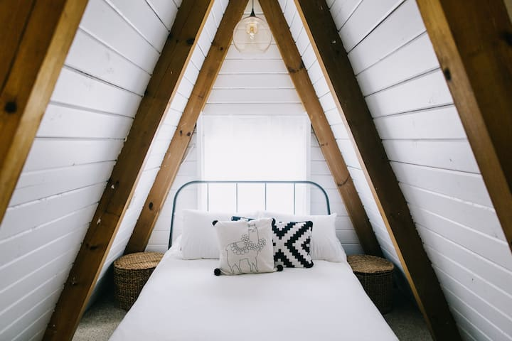 Grab a good book and curl up on the bamboo full size mattress in the loft.