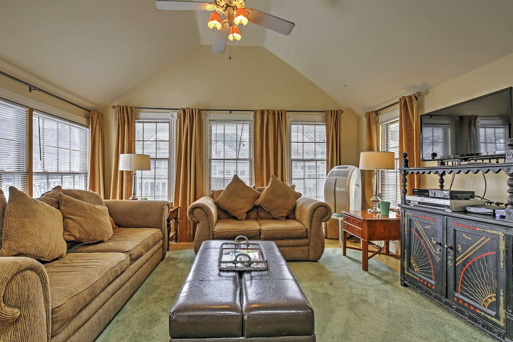 Enjoy lounging in the inviting living room, complete with a flat screen TV.