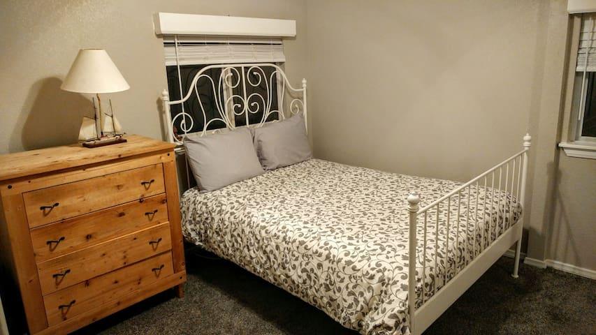 Quaint bedroom located in trendy neighborhood