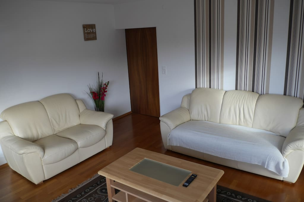 Extra large living room. with awesome view. Includes leather couches and chairs, a Tv with satellite.