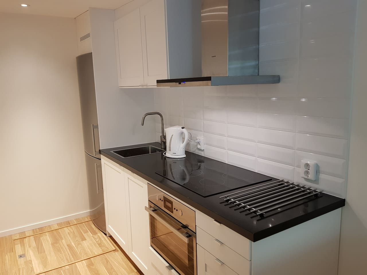 Complete kitchen for four persons with dishwasher.