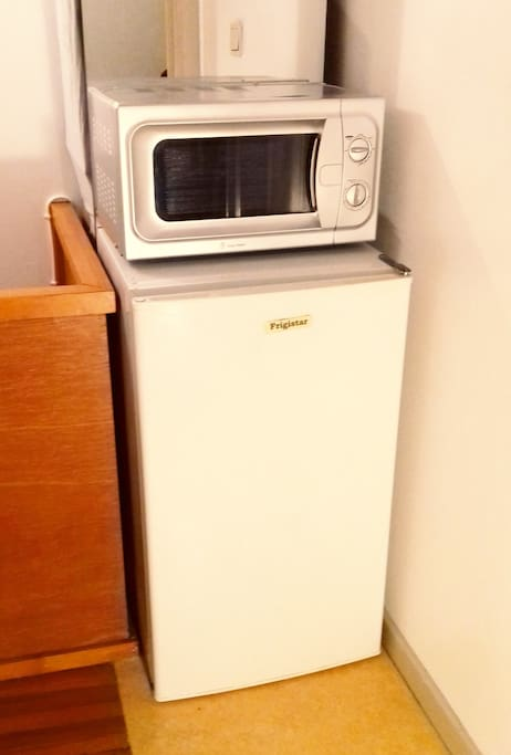 Refrigerator and microwaves at the door of the private Bedroom.