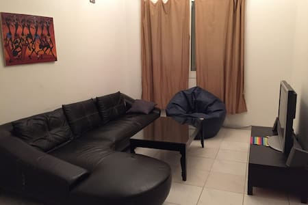 Private Room in Neat and Tidy Apartment - Sharjah